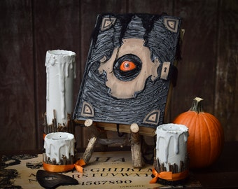 Book of the Damned • Halloween Decor • Spell Book & Wood Stand • Witch Halloween Decoration • Black Spellbook • Orange Eye • Leather Strap