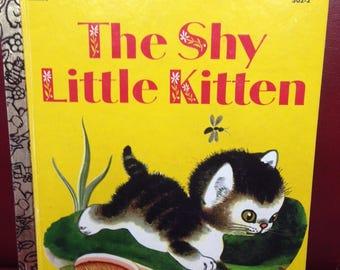 The Shy Little Kitten. A Little Golden Book