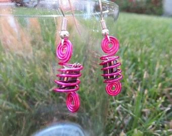 Pink twisted wire earrings with metallic gray bead