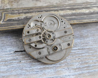 Antique pocket watch movement to use in your art project.