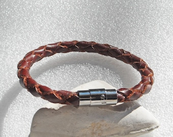 "Brown leather bracelet with stainless steel magnetic clasp. Choose the braclet size from 6.5 to 9"" around. Hand braided. S-42. 7 8 9 inch"