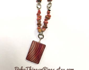 Pink rhodochrosite stone and shell necklace