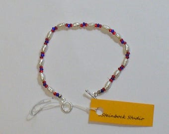 Fresh water pearl bracelet in red, white and blue