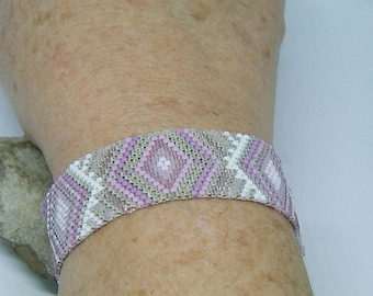 Pink, white and silver hand-woven bracelet