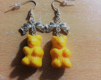 Yellow bear pierced earrings.