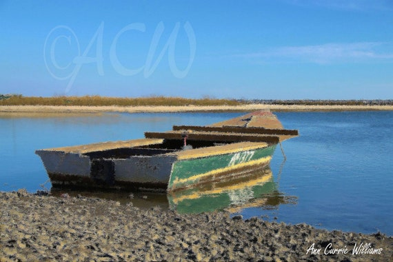 Green Apalachicola Oyster Boat in East Bay Florida