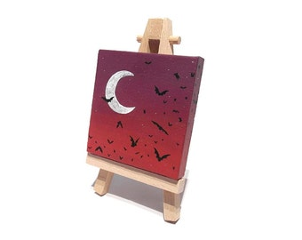 Bats at Dusk Miniature Painting - purple and red sky with bat silhouettes in front of a crescent moon on mini canvas, with easel or hanging