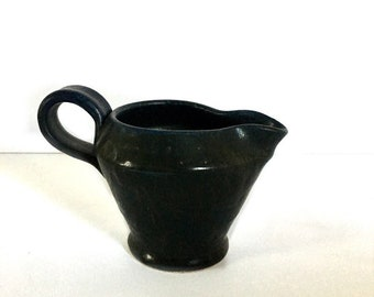 Handmade pottery cream jug