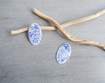 X 2 white and dark blue oval sequins
