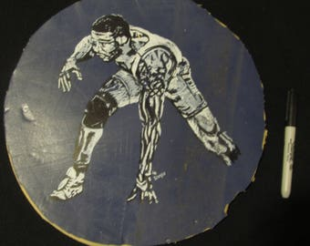 Jordan Burroughs USA Wrestling pen and ink portrait on real wrestling mat