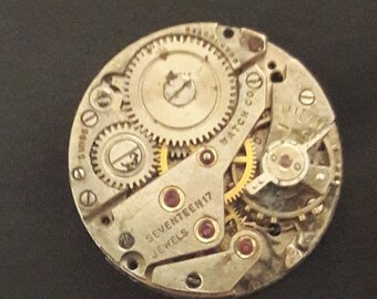 Genuine vintage watch movement tie pin / lapel pin.  Steampunk Collection