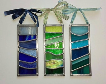 Traditionally handmade stained glass striped rectangular panel.