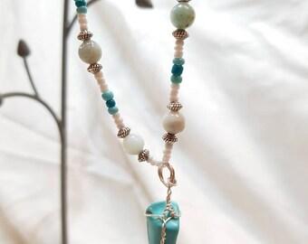Turquoise wrapped pendants set