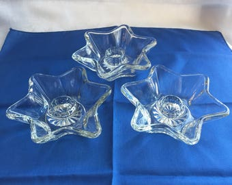 Clear glass star candlestick holders