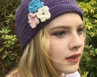 crocheted hat with flower trim