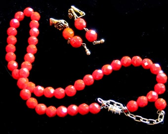 Red glass beads necklace and matching clip earrings