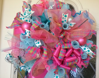 Deco mesh wreath bright colors, pink and turquoise.Great to brighten any door.