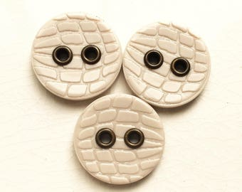 eco friendly ecru white reptile stamped design buttons with brassy metal holes--matching lot of 3