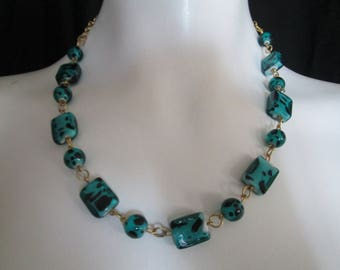 Artisan created teal and black lampwork glass beaded necklace with gold chain accents