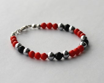 Gem bracelet : red coral, black onyx, hematite and silver
