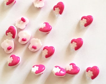5 heart-shaped pink buttons