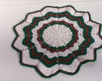 White, green, and brown hand-crocheted doily