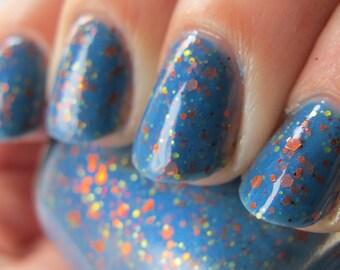 Raptor Girl Nail Polish - azure blue with orange and warm toned glitter