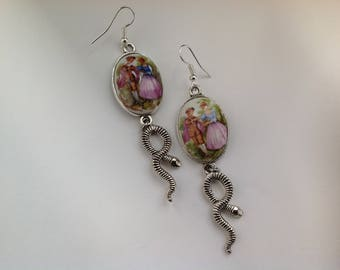 silver color, a dangle earrings