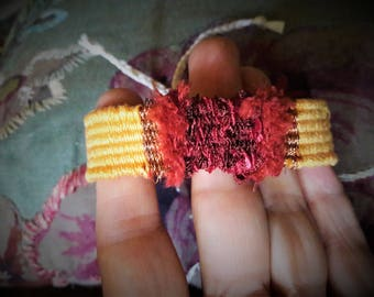 Yellow, Brown, red woven bracelet