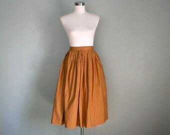 F E A T U R E D . 1950s vintage cotton CHESTNUT full circle skirt