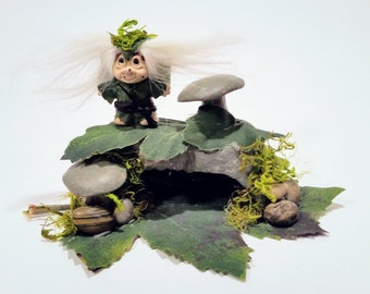 Mini, Troll, a mythical, cave-dwelling being depicted in folklore as either a giant or a dwarf, typically having a very ugly appearance