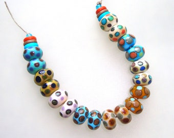 Handmade Lampwork Glass Beads - 9 pairs (18 beads). Stacked dots on various colors. Ivory, turquoise, caramel, mustard. Earring pairs.