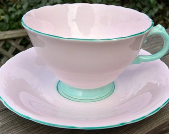 Perfect Pink: Delphine Pastel Pink and Mint Green Teacup and Saucer