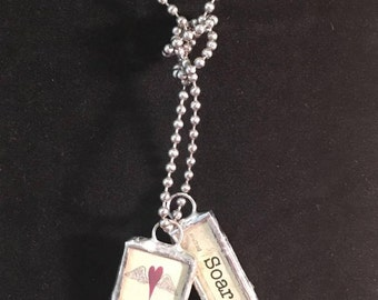 Winged heart and soar charm necklace
