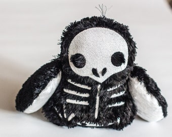 Plush Fluffy Skeleton 'Is it a Bird, an Owl, or a Penguin?'