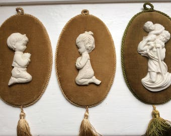 3 1960s Vintage Italian Porcelain Wallhanging Figures on velvet.