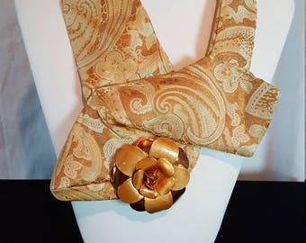 Women's necktie made from a repurposed necktie. Necktie jewelry made from an upcycled necktie