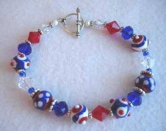 Bracelet with lamp work beads and crystals, red, white and blue, patriotic, July 4th