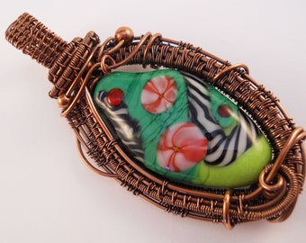 copper wire woven pendant green lampwork tabular bead with pink flowers and black and white cane