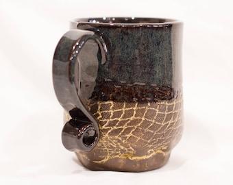 Hand-built mug with brown-blue glaze and snake skin texture