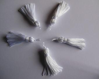 A white color rayon thread tassel