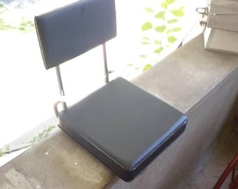 Fold-up Stadium Seat in Black Plastic / Vinyl