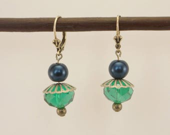Earrings in silvery metal, synthetic Pearl teal and turquoise faceted glass bead.