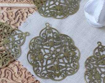 Set of 10 bronze metal Oriental prints