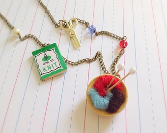 Knitting Enthusiast Necklace. Miniature How to Knit Book. Craft Lover. Miniature Bowl of Yarn. Charm Necklace. Red. Blue. Vintage Style Cute