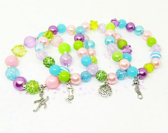 Under the sea mermaid party favor bracelets in organza bags with special birthday girl bracelet
