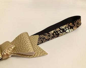 Leather bow metallic find joy elastic headband