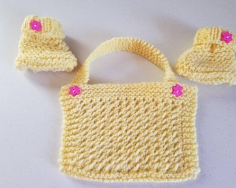 Baby booties and bib set in bright yellow