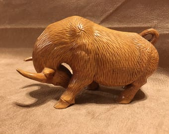 Hand carved wooden oxen, maple colored wood, very intricate, awesome detail