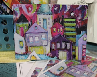 Colorful and whimsical  Beach and River Houses  in a note card colors of purple, magenta, green and lavender    by Jodi ohl